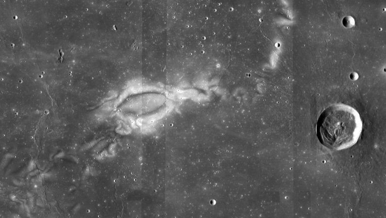 The lunar swirl Reiner Gamma (Reiner crater is on the right), showing the lovely if baffling pattern on the lunar surface. Scientists are now confident these swirls are due to magnetism affecting solar wind erosion. Credit: NASA LRO WAC Science Team