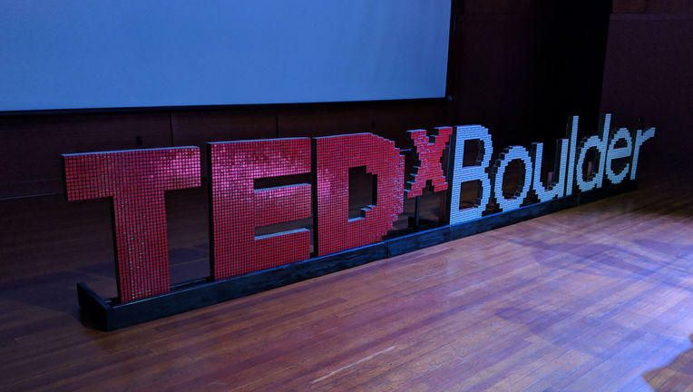 The 2018 TEDxBoulder logo on stage. Yes, it's made out of Rubik's cubes, designed and built by speaker Dan Van der Vieren. Credit: Phil Plait