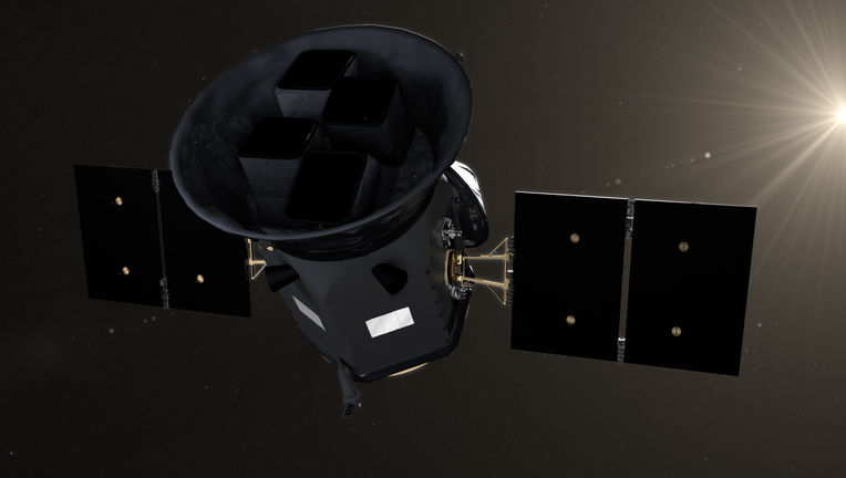Artwork of the TESS observatory in orbit. Credit: NASA's Goddard Space Flight Center/CI Lab