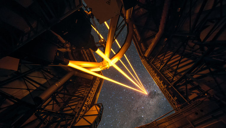 Four lasers beam into the sky to help sharpen images taken using the Very Large Telescope. Credit: ESO/F. Kamphues
