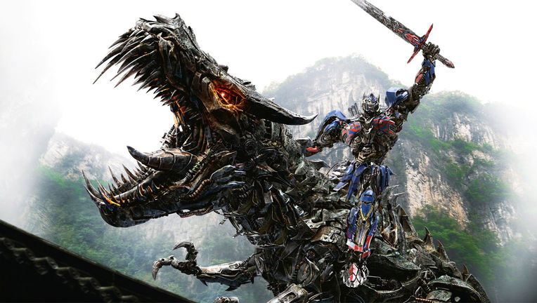 Optimus-Prime-Riding-Grimlock-Transformers-Extinction.jpg