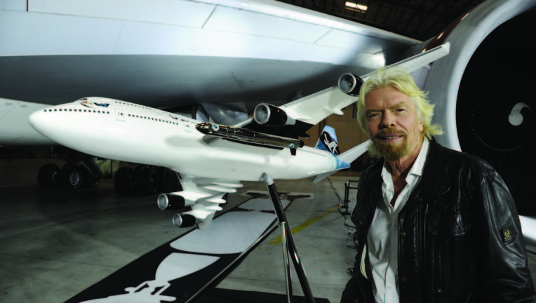Richard_Branson_with_747_and_LauncherOne_Model.JPG_cmyk_0.jpg
