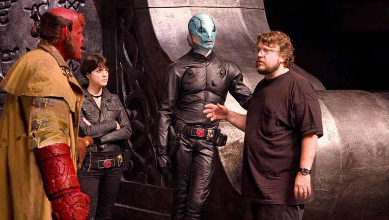 Ron-Perlman-Selma-Blair-Doug-Jones-and-director-Guillermo-del-Toro-on-the-set-of-Hellboy-2-hellboy-ii-the-golden-army-3963232-1200-796.jpg