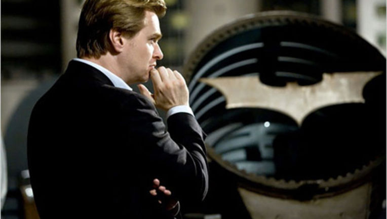christopher-nolan-and-bat-signal_0.jpg