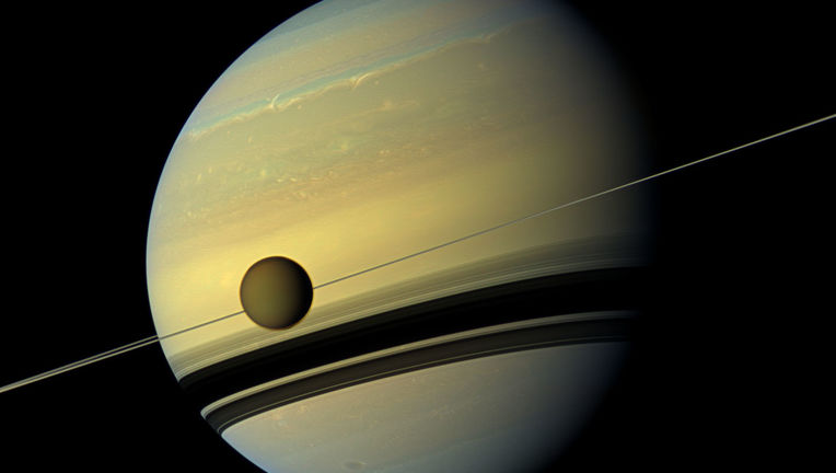 natural-color-view-of-Titan-and-Saturn-from-NASAs-Cassini-spacecraft.jpg