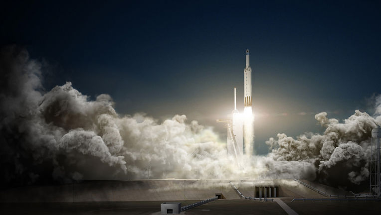 artwork of a Falcon Heavy launch