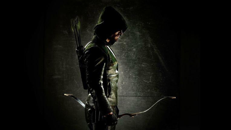 stephen-amell-in-green-arrow-costume-wallpaper.jpg