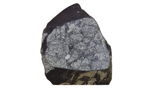 The brecciated structure is apparent after a part of the San Marco meteorite was sawed off. Credit: Demarco et al.