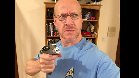 Phil Plait holding a phaser