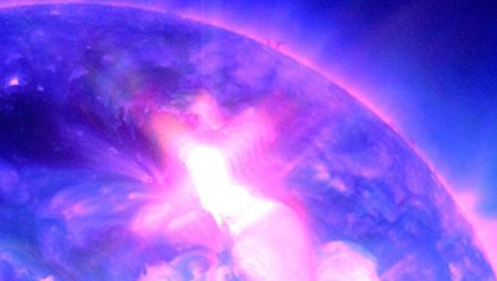 Enhanced photo of ultraviolet flash from an intense solar flare.